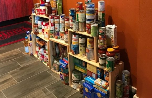 Stack of canned and boxed food donations.