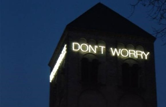 Don't Worry Neon Sign on Building