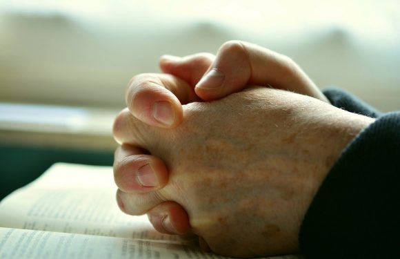 Hands folded in prayer