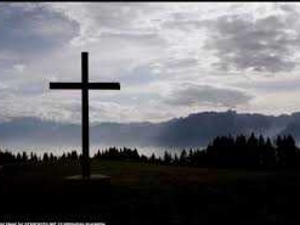 Cross with Mountains & tress in the background