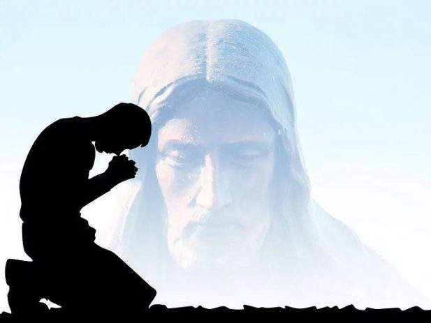 Faded image of Jesus bending down while a person prays