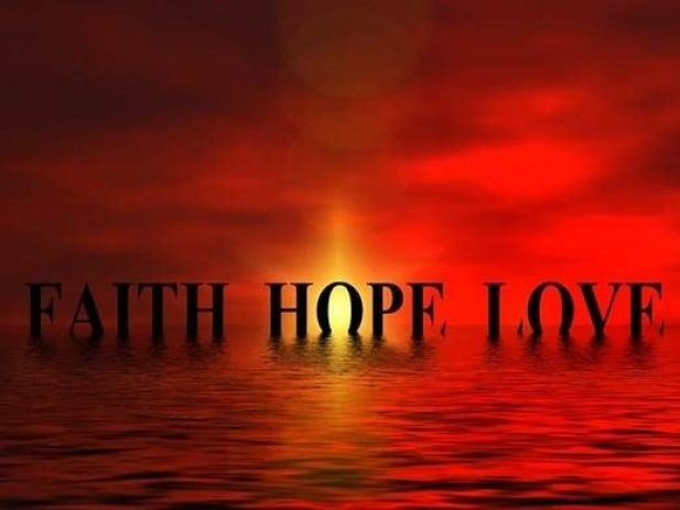 Red sunset with words faith, hope, love