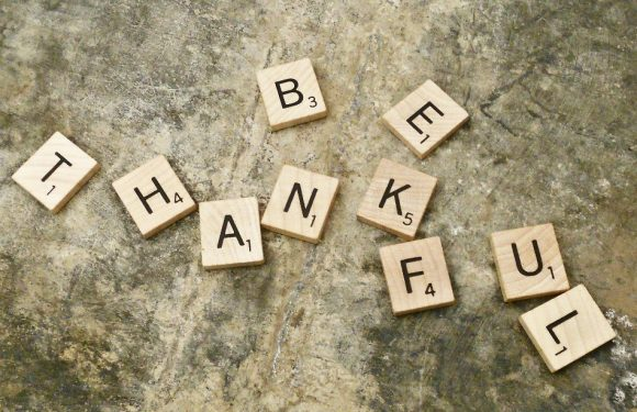 "Scrabble Letters spelling out ""Be Thankful"""