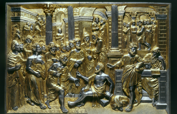 Carved gold image of bible story