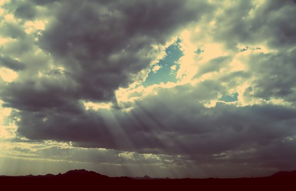 Sun beams shining through clouds