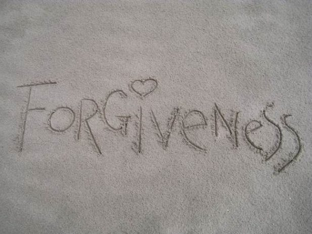 Forgiveness written in the sand